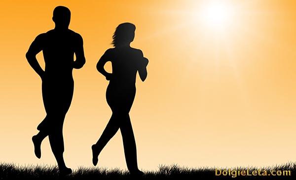 Двигательная активность: силуэты бегущих женщины и мужчины