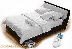 Фото электроматраса на кровати.