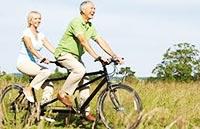 Велопрогулки вдвоем на велосипеде тандем.